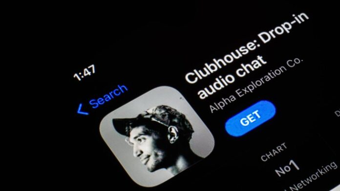 in this photo illustration, the clubhouse app seen displayed